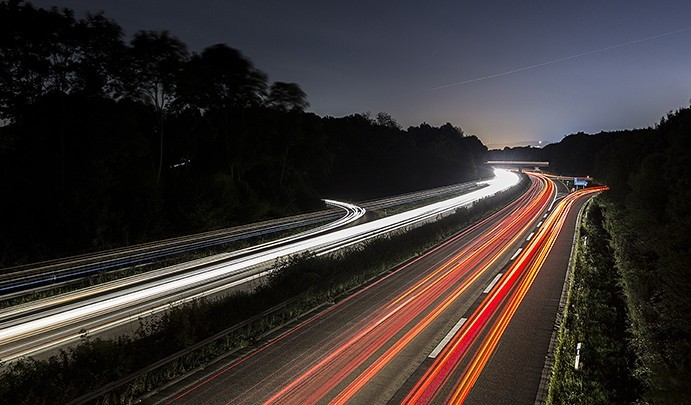 light trails at night on a highway